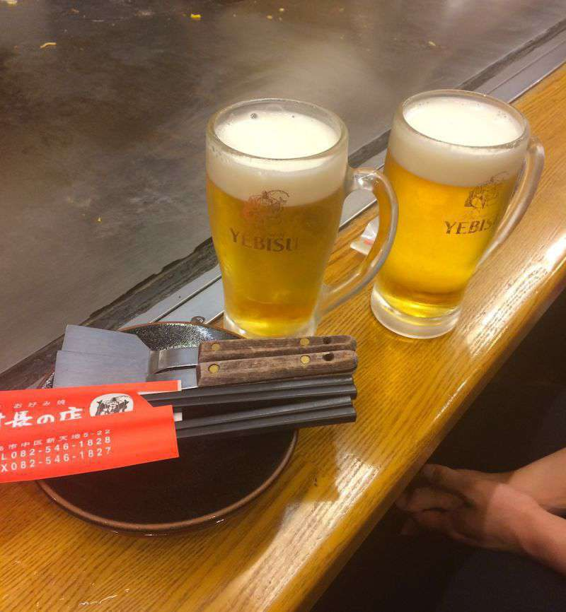A cold beer is the best accompaniment to okonomiyaki