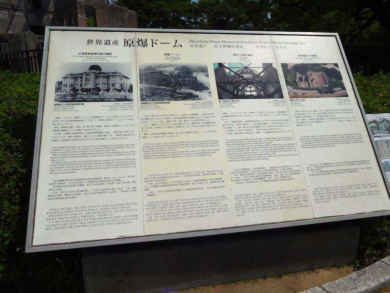 The information board at the Hiroshima Peace Memorial describes the history of the Atomic Bomb Dome in English