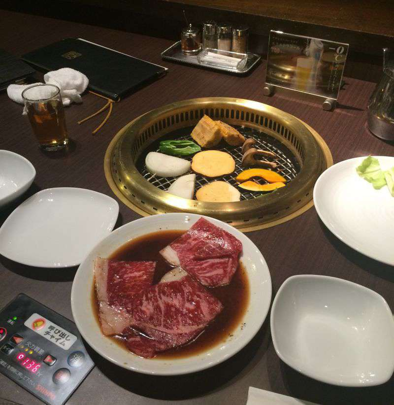 Tendan yakiniku restaurant - meat and vegetables on the barbeque grill!